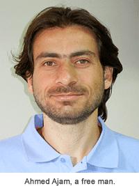 Head shot of Ahmed Ajam wearing a light blue shirt