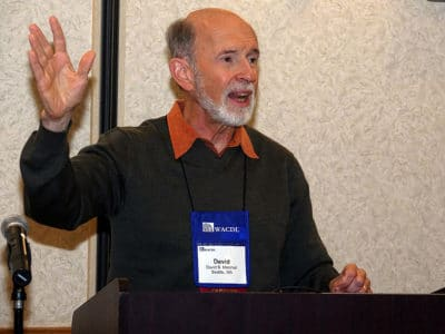 David Marshall raising his hand as he speaks at the WACDL's Annual