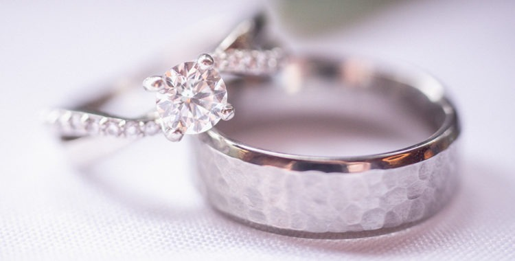 Set of silver engagement rings: one feminine, one masculine