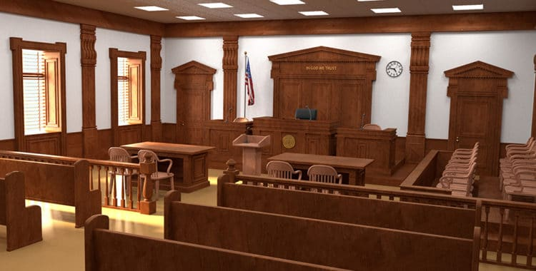 empty courtroom with brown benches and white walls