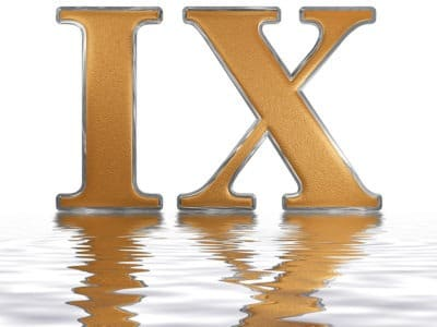 gold Roman numeral IX reflected on water isolated on white background