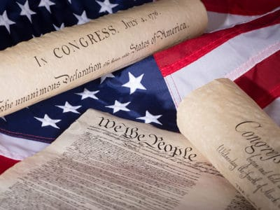 United States Declaration of Independence, Constitution, and Bill of Rights on an American flag