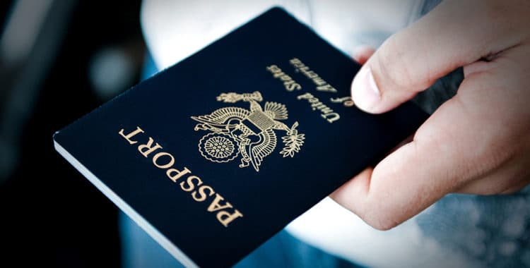 close-up of a person's hand holding a U.S. passport