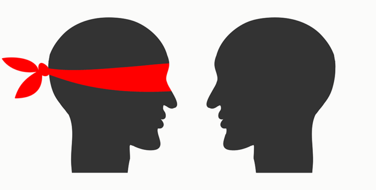 two silhouettes of heads, one with a red blindfold and one without a blindfold