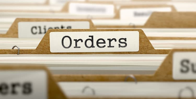 "Selective focus of file tab with ""Orders"" written in black letters on a white label"