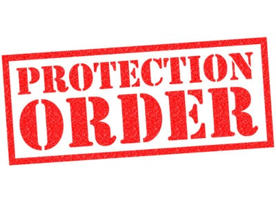 PROTECTION ORDER red rubber stamp over a white background.